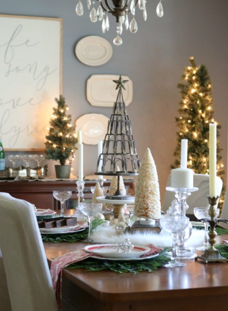 Festive Christmas Table design with elegant elements and mini trees