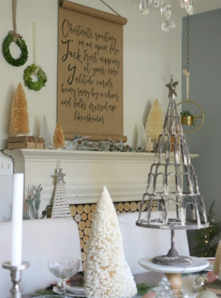 Create festive holiday table with hanging wreaths and DIY fireplace