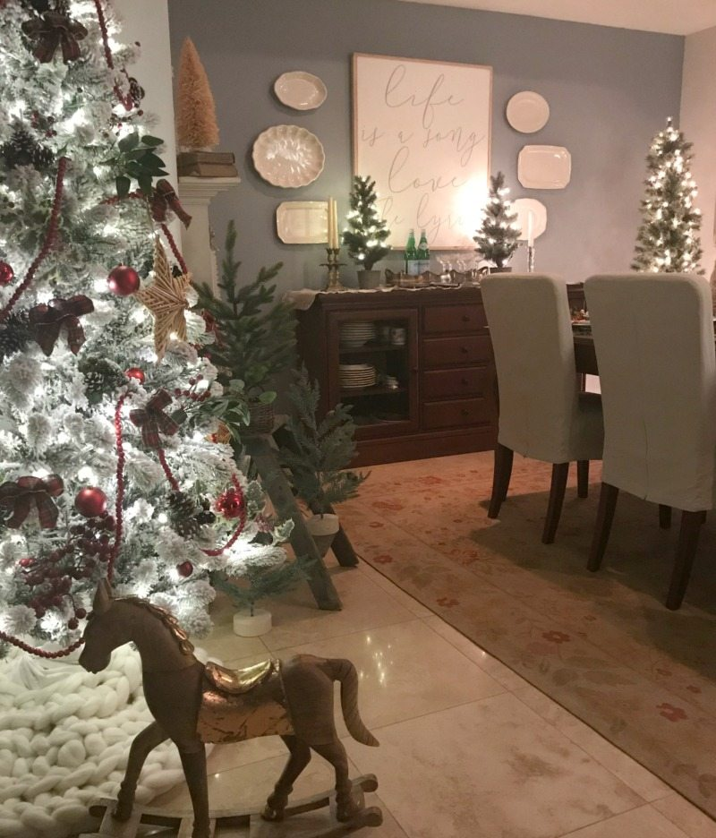 Festive Table Decorations with magical christmas trees and rocking horse