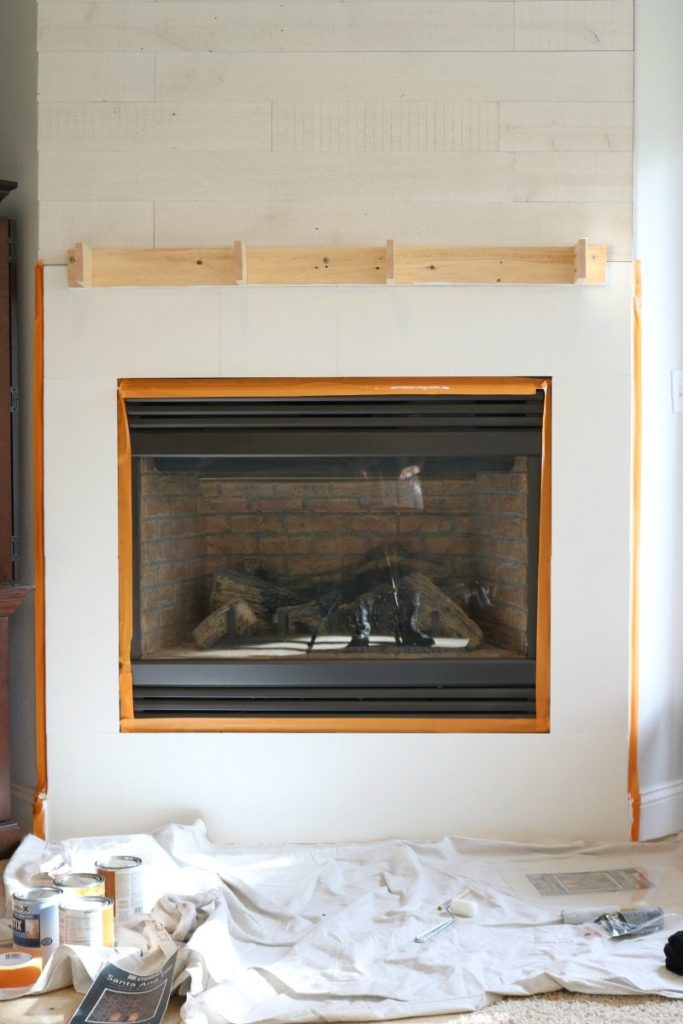 Stencil fireplace makeover before photo
