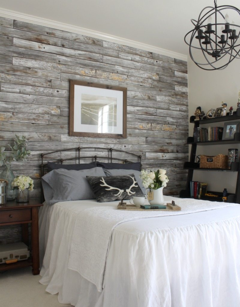 Bedroom with faux timber wallpaper called Rustic Wood Panels from Milton & King