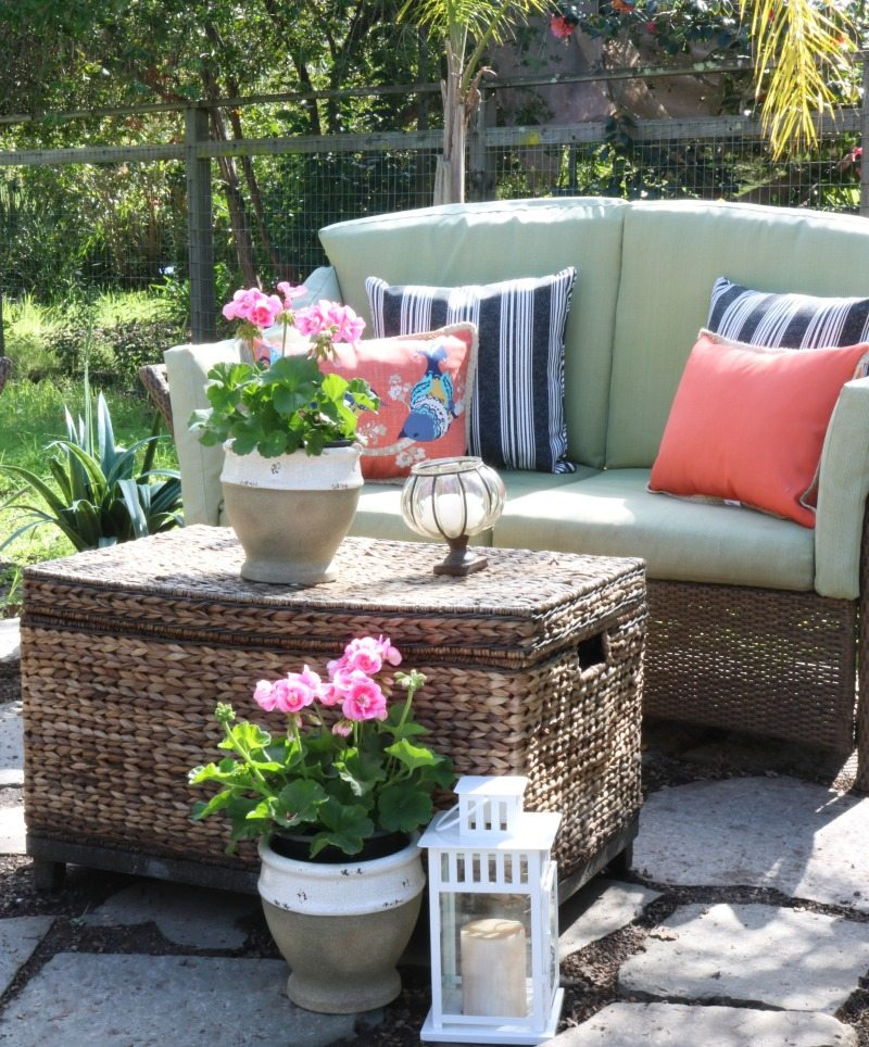 bright patterned pillows create cozy outdoor oasis