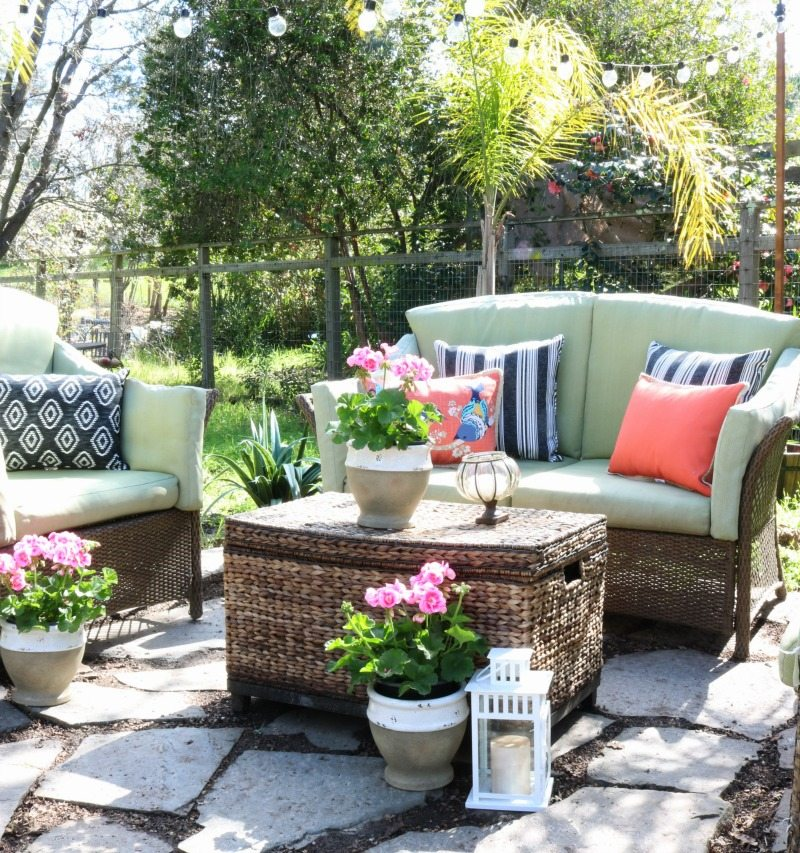 pretty outdoor oasis with pillows and flowers
