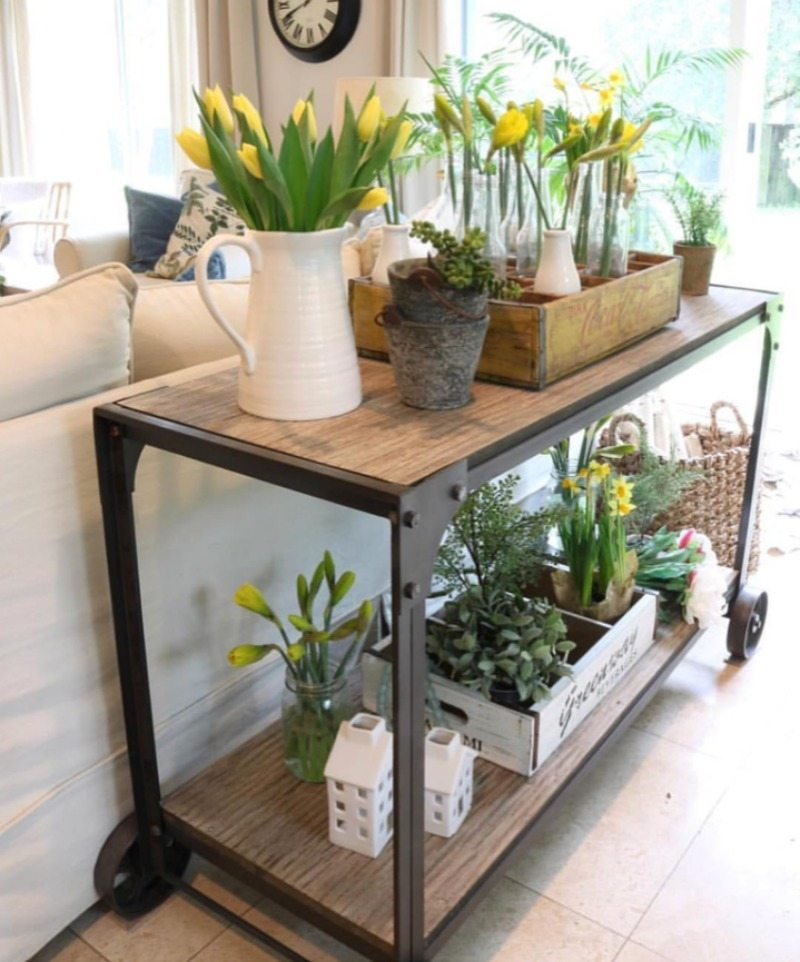 yellow flowers on bar cart
