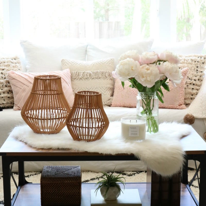 pink decor pillows with accent items and white faux fur throw