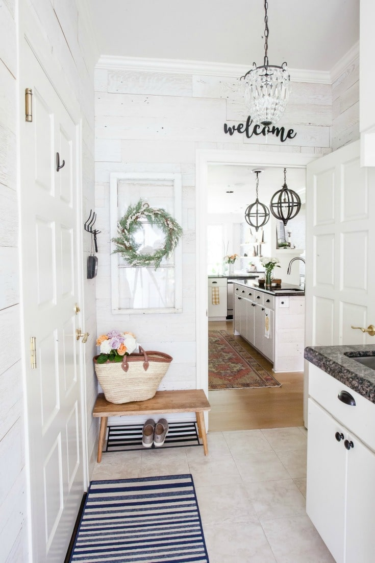 Laundry room farmhouse style makeover with real barnwood wall treatment