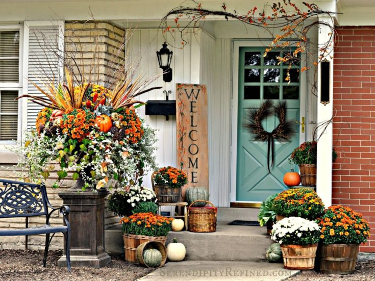 fall front porch with mums and festive decor
