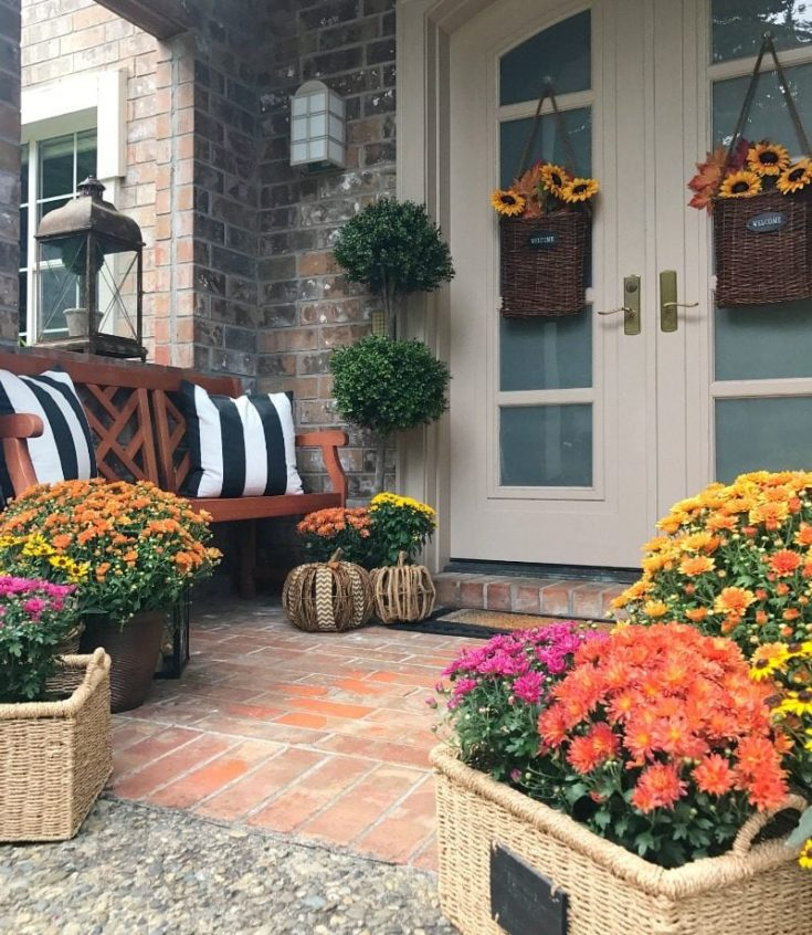 fall front porch with pillows and mums