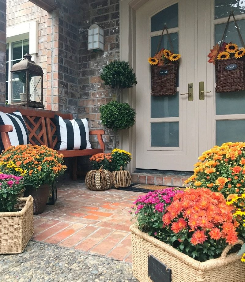 colorful fall flowers and fall door baskets
