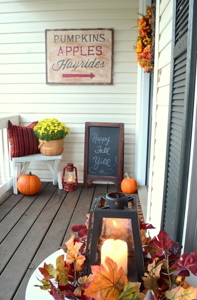 chalkboard signs with orange pumpkins and candle lanterns