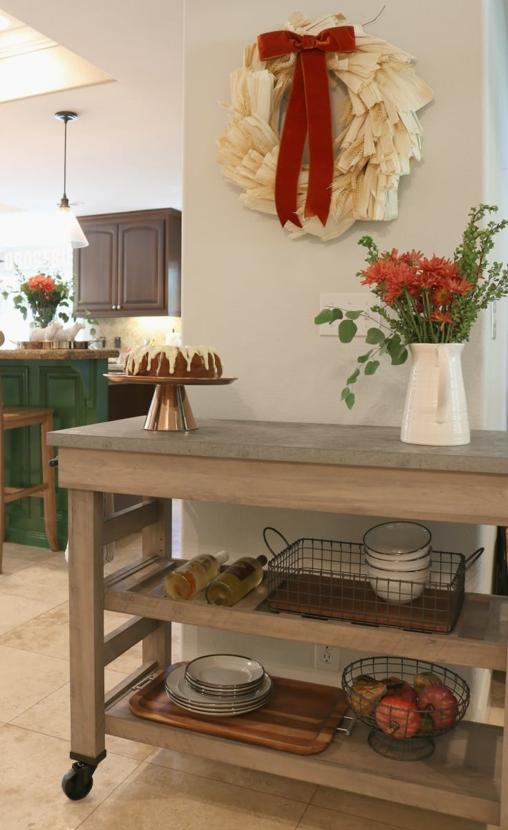 kitchen island with flowers and cake