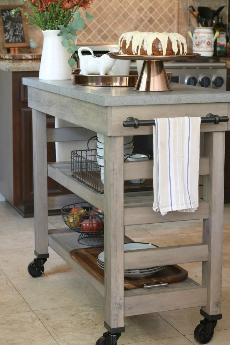 full cart island in farmhouse kitchen