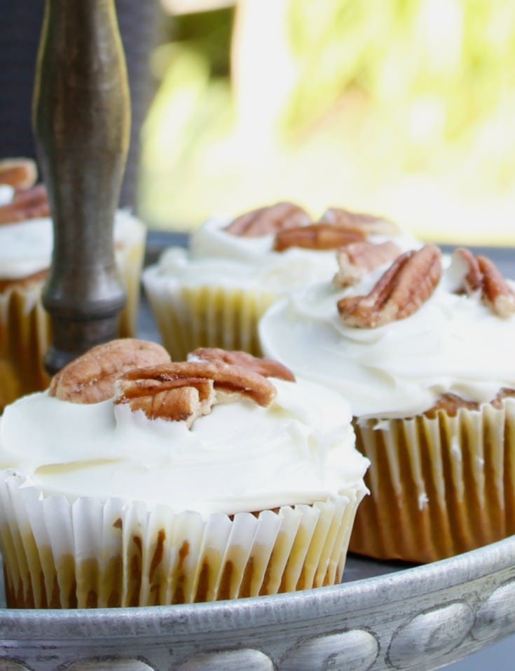 pumpkin spice cupcakes with pecan garnish for fall