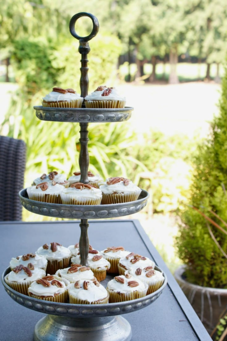 three tiered tray with pumpkin cupcakes