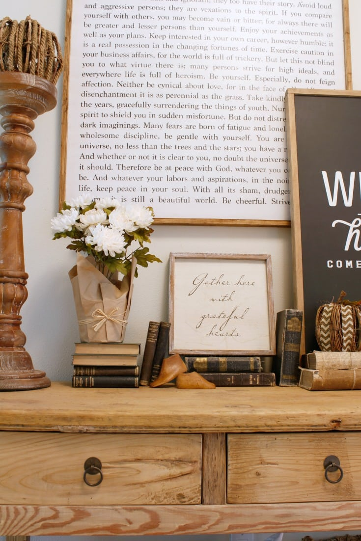 farm table and farmhouse sign with vintage books as decor