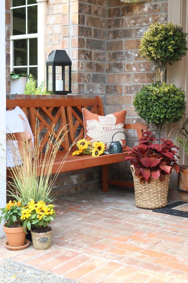 festive fall front porch with bench and mums