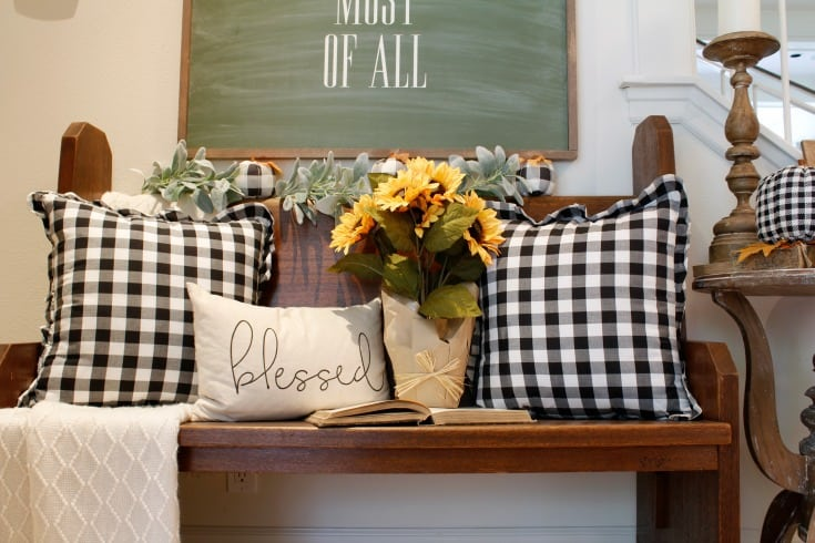 fall pillows black and white on vintage church pew bench
