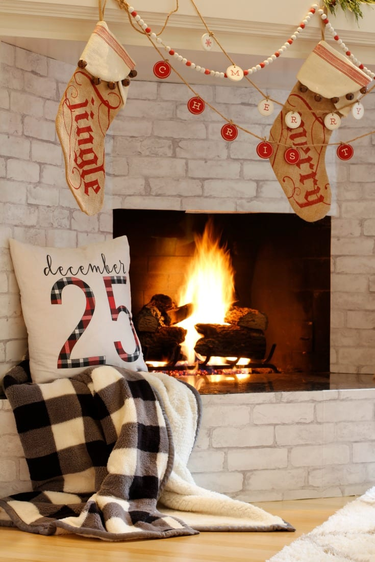 cozy fireplace christmas decor with festive stockings and garlands