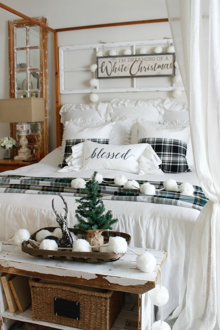 Neutral winter bed with pompoms