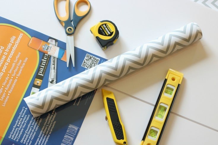 grey and white zig-zag contact paper with scissors and measuring tools