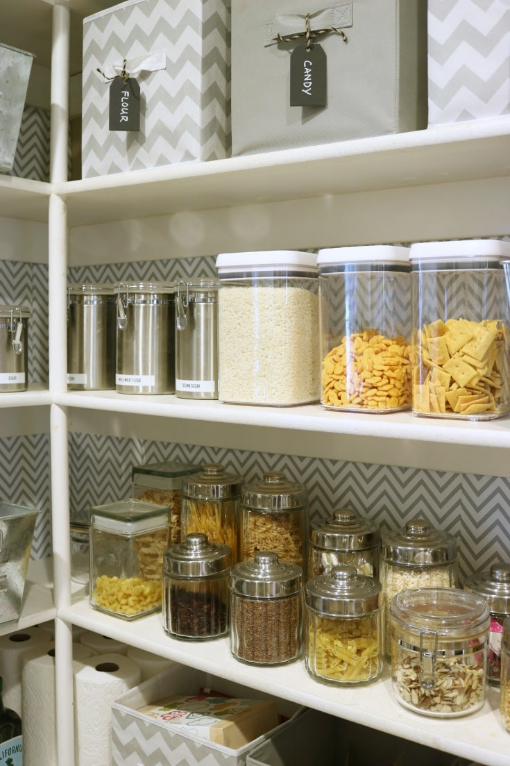organized kitchen pantry shelves with clear food containers with labels