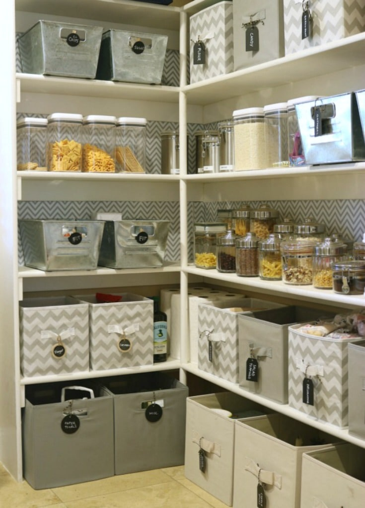 organized food bins on pantry shelves