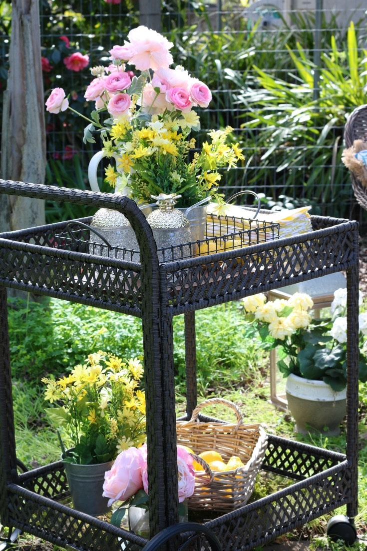outdoor serving cart with spring flowers