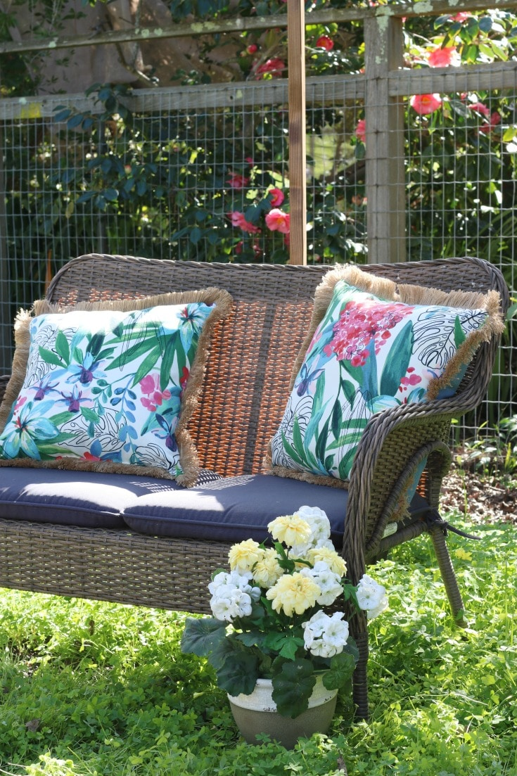 backyard wicker seating with spring pillows