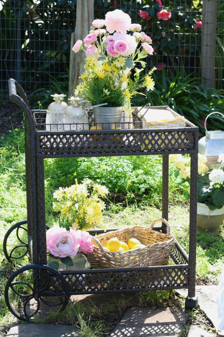 outdoor garden party serving cart with flowers