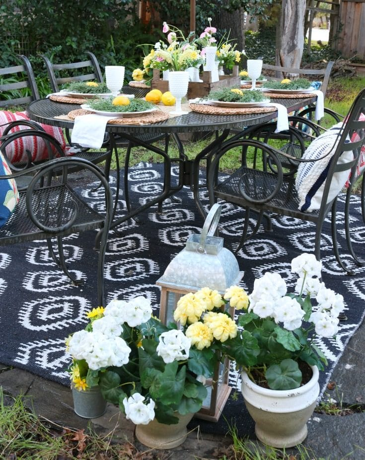 backyard garden party table setting with flowers