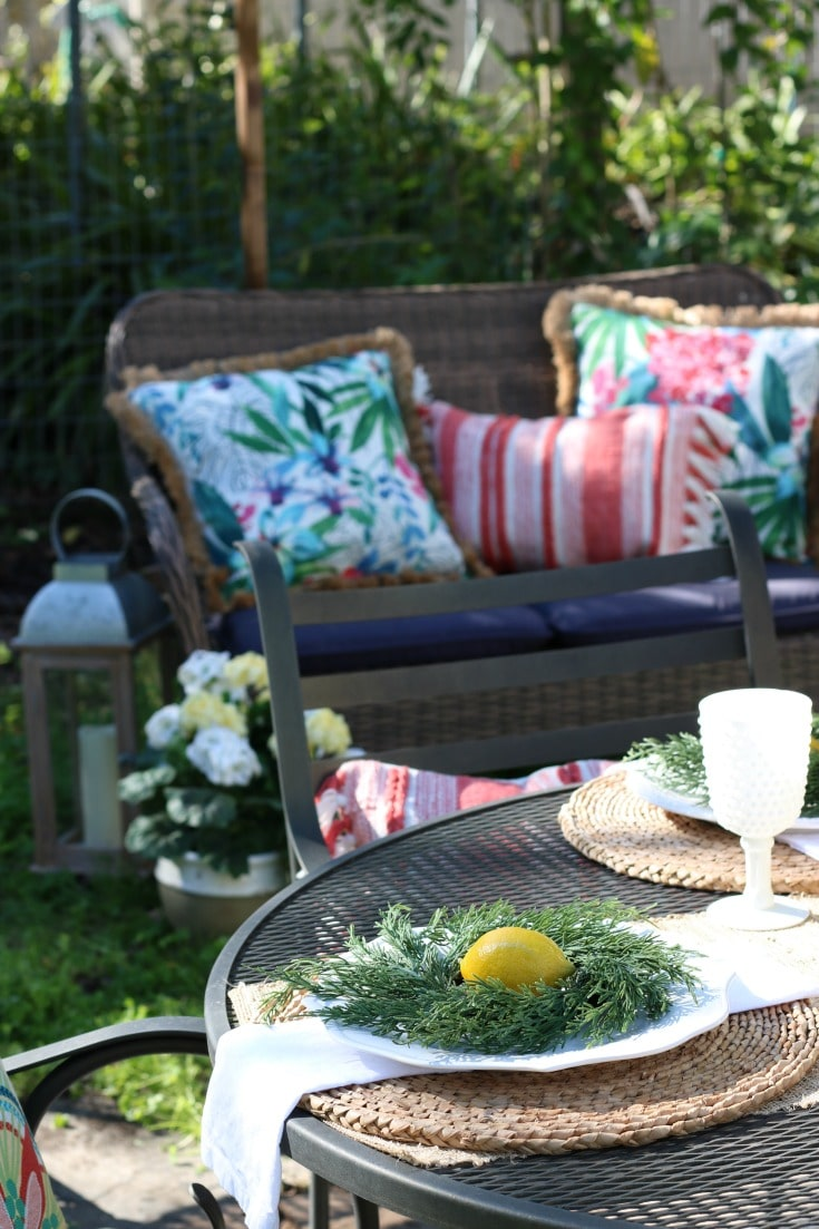 garden party setting with spring pillows