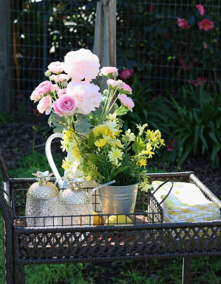 Backyard spring flowers and serving cart