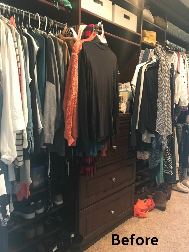 cluttered master closet wood shelves