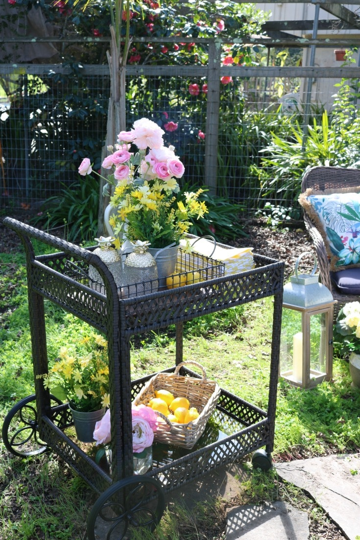garden party serving cart with flowers