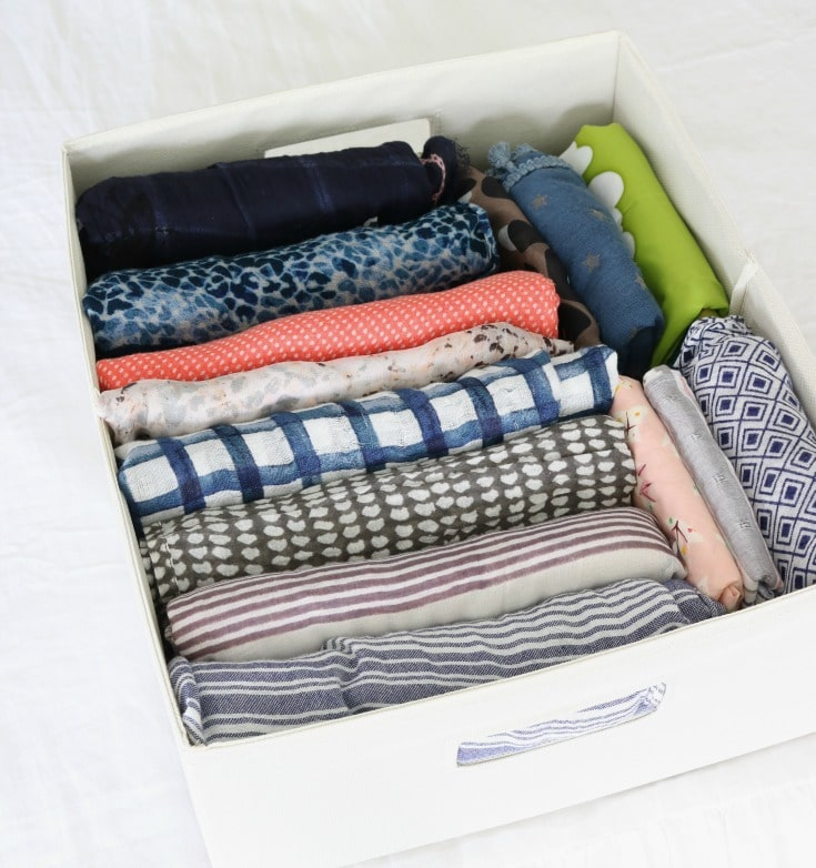colorful folded organized scarves in bin using Marie Kondo organizing method