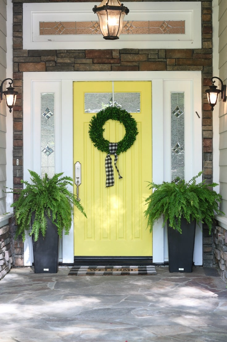 Decorate your front door with ferns for summer decor