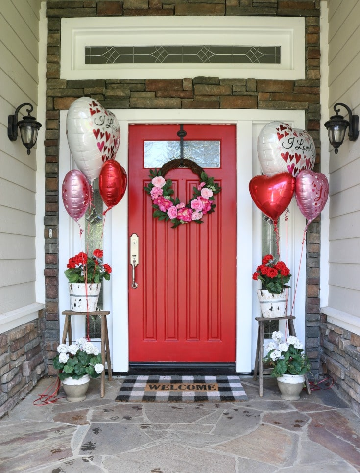 Create the most festive holiday door decor for Valentines day with a red door and balloons.