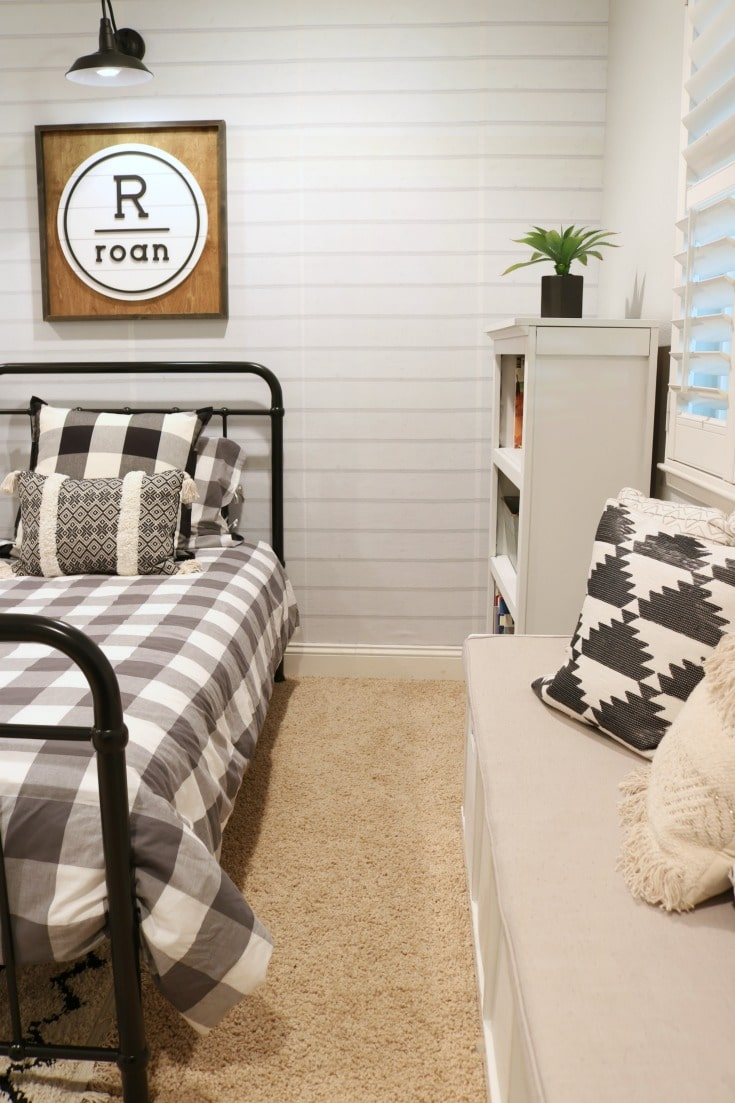 Cool Kids bedroom with neutral colors, mixed patterns and fun pillows