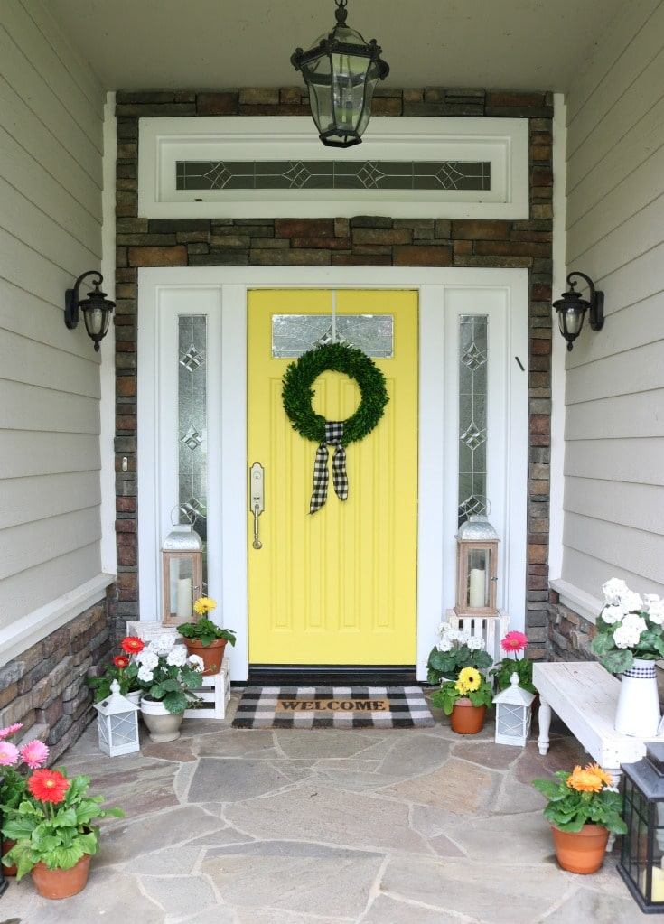Decorate your front door with a bright bold paint color and fresh colorful flowers this spring.