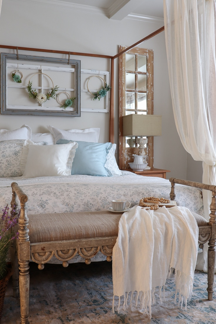 romantic canopy bed with floral bedding and rich fabrics