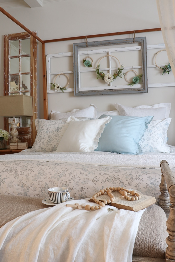 romantic bedding details with floral printed comforter and hoop wreaths sheer curtains