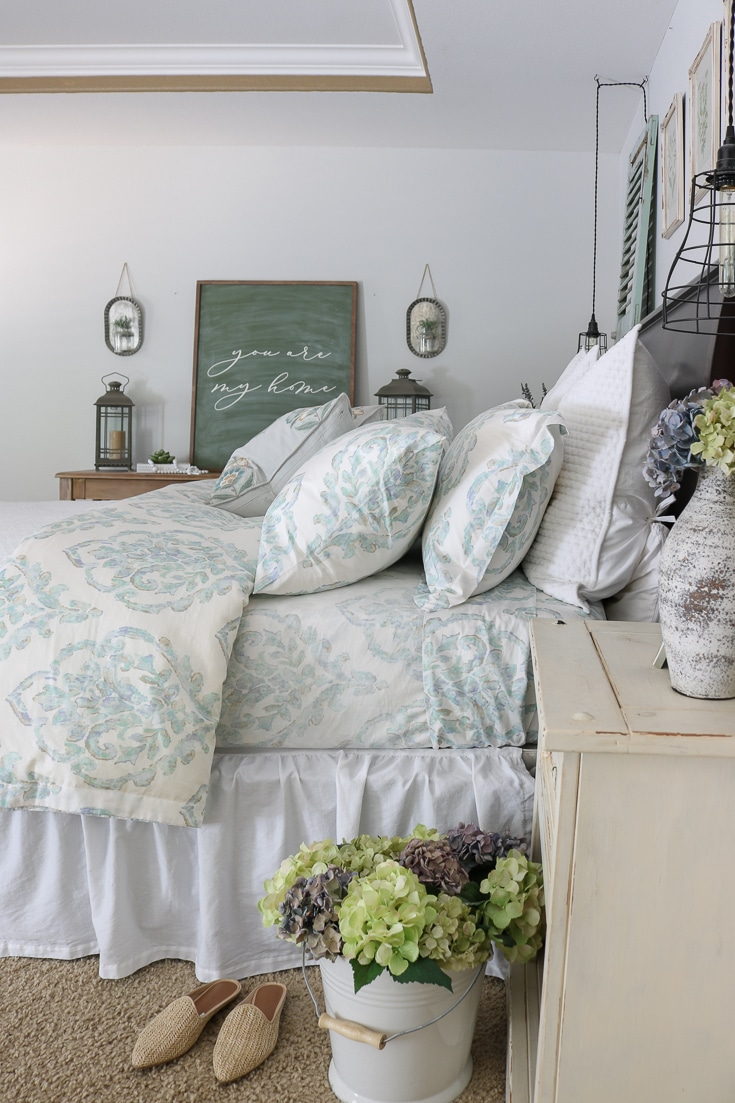 romantic bedroom details dried hydrangeas floral sheets and luxury bedding