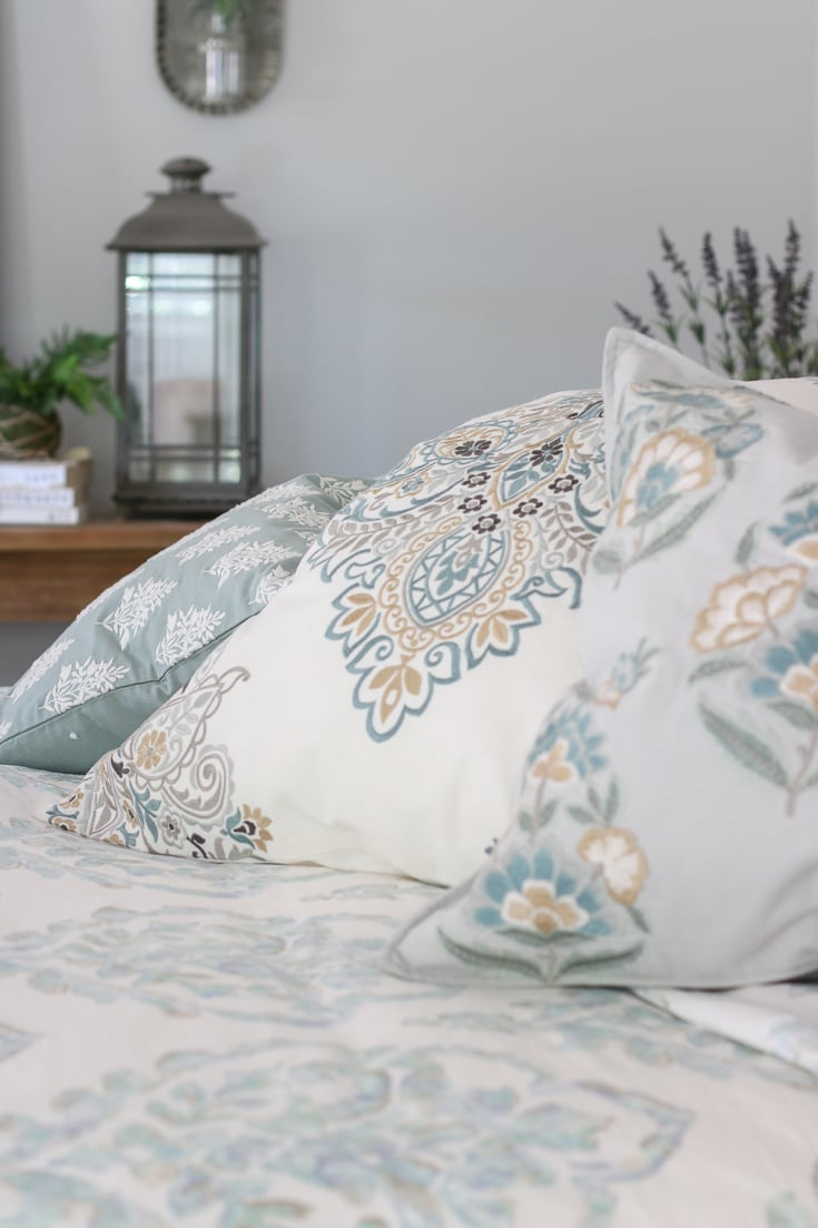 Bedding details with soft colors and textures lantern