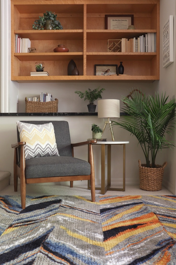 new mid-century modern chair and side table spark joy in bedroom makeover