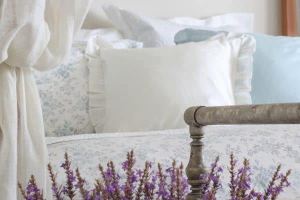 beautiful bed with lavender throw pillows shears and printed comforter