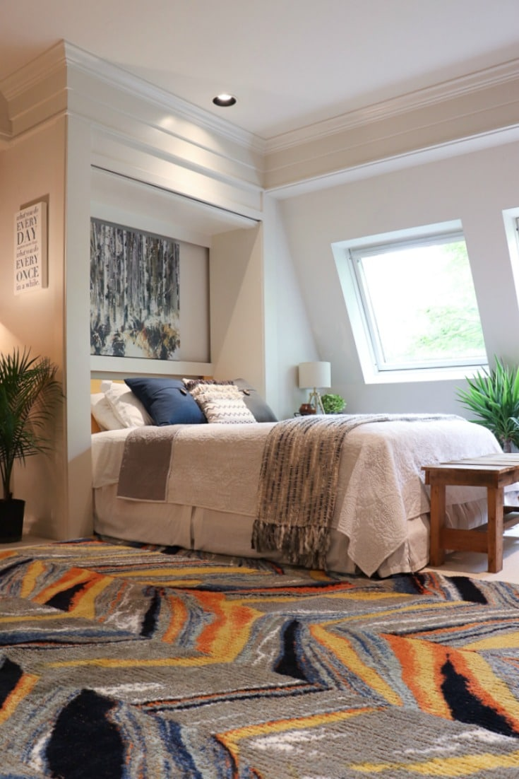 new rug and pillows spark joy in bedroom style makeover
