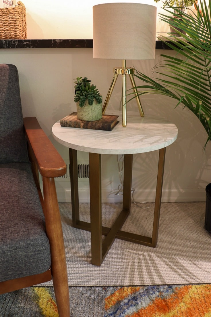 spark joy with new decor details side table and modern gold lamp