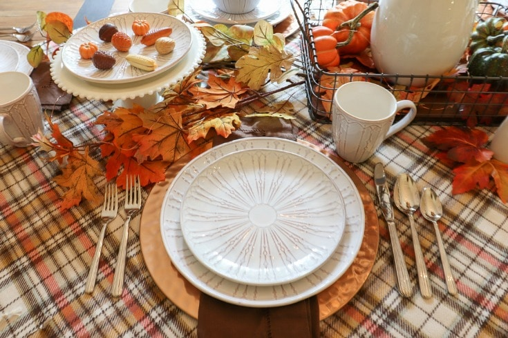 Welcome your guests with a festive fall table updated with the warm cozy colors and scents of the season.