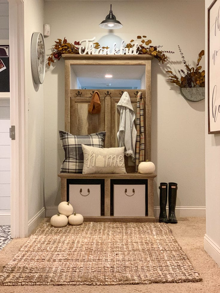 Organized hallway creates stylish entryway and functional storage with seasonal welcoming decor