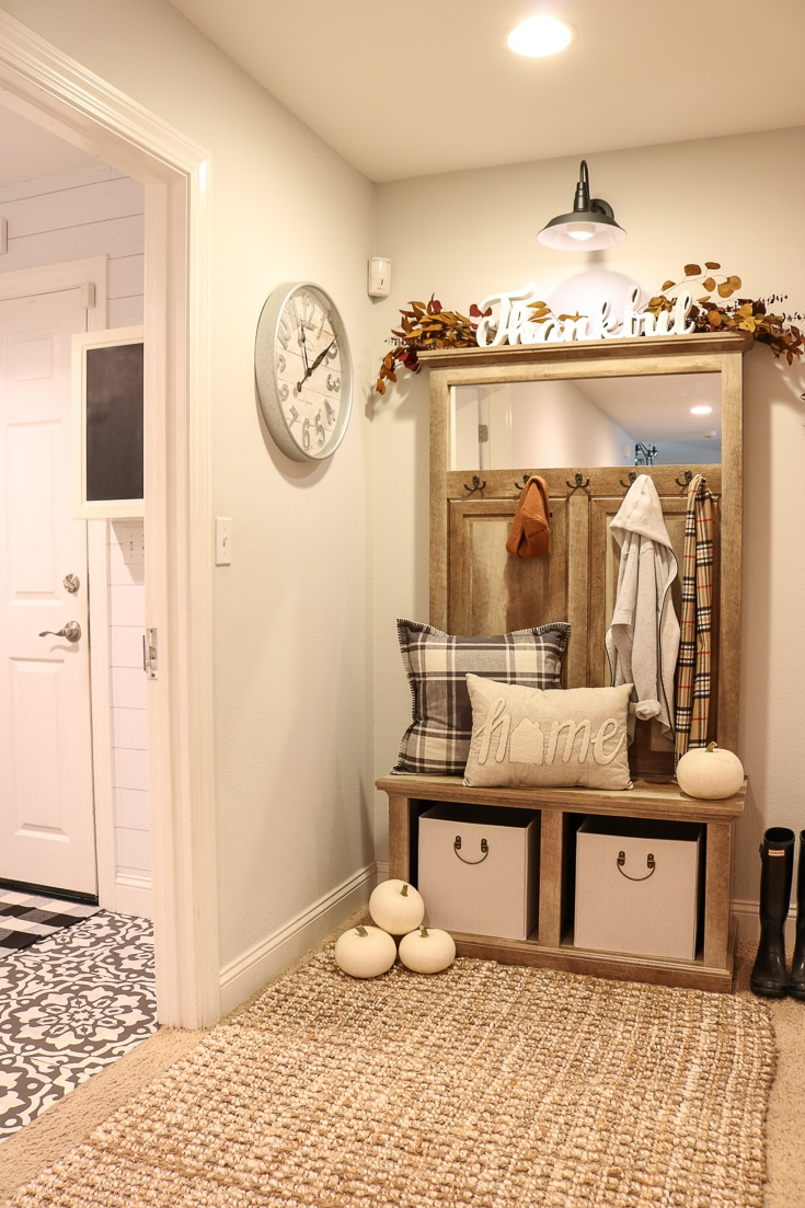 Farmhouse style entryway bench and storage unit solves all your entryway needs